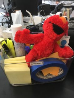 Elmo acronym, the cute red monster from Sesame Street, in our supply caddy